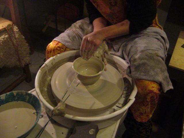 Julie Wild realizing a sandstone bowl