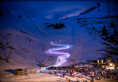 Torchlight descent by ski instructors